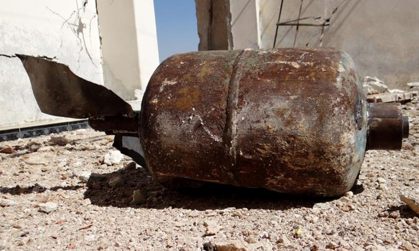 """The caption of this image on the Guardian currently reads:  """"An unverified photo of an unexploded barrel bomb alleged to contain napalm gel."""""""